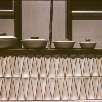 Promotional photograph of Heath Ceramics casseroles and tile